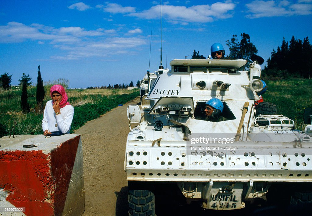 Military troops with the United Nations Interim Force in Lebanon (UNIFIL) question a Lebanese women during their patrol of the coast of Naqoura along the Mediterranean Sea. The UNIFIL, established in 1978, was created to confirm Israeli withdrawal from Lebanon and help restore the authority of the Lebanese government.
