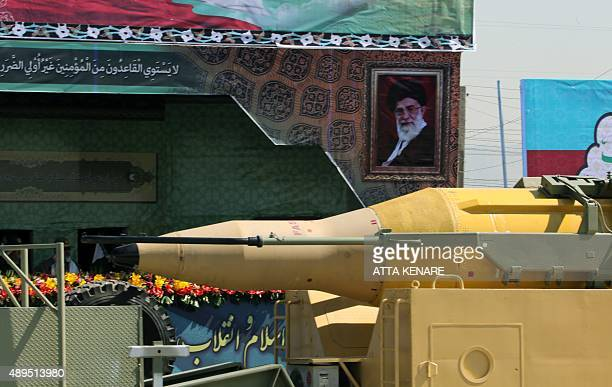 A military truck carries a Qadr mediumrange missile past a portrait of Iranian supreme leader Ayatollah Ali Khamenei during the annual military...