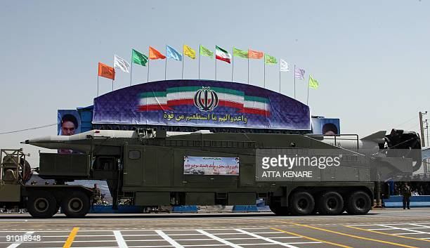 A military truck carries a Sejil missile during an annual military parade which marks Iran's eightyear war with Iraq in the capital Tehran on...
