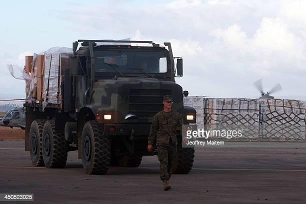 US military truck carrying food aid is seen at the airport following the recent super typhoon on November 19 2013 in Tacloban Leyte Philippines...