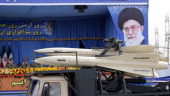 A military truck carrying Shalamcheh missiles drives past the presidential rostrum during the annual Army Day military parade on April 18 2014 in...