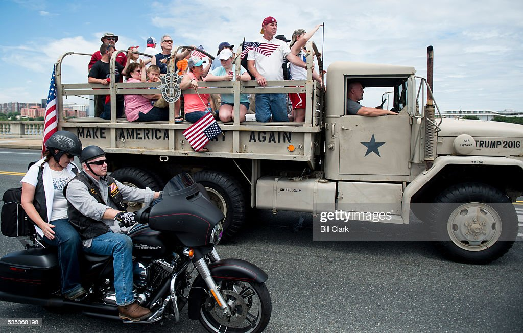 A military truck painted with the words 'Make America Great Again' and 'Trump 2016' drives along with Rolling Thunder bikers as they pass over Memorial Bridge to the Lincoln Memorial during the annual Memorial Day Rolling Thunder ride in Washington on Sunday, May 29, 2016. Republican presidential candidate was expected to speak at the event later in the afternoon.