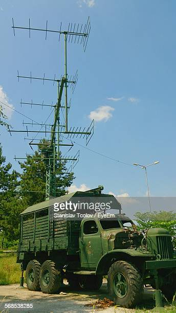 Military Truck Parked By Antenna