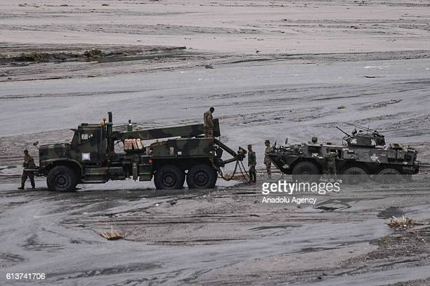 S military truck prepares to tow a Philippine Marine APC which got stuck from a muddy part of a riverbed in an annual livefire joint USPhilippines...