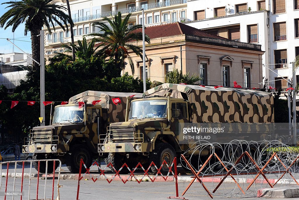 Military trucks are parked on the Habib Bourguiba Avenue as the state of emergency is declared since the fall of ex-president Ben Ali of Tunisia on January 31, 2013 in Tunis. Tunisian President Moncef Marzouki should decide today wether to continue the state of emergency or not.