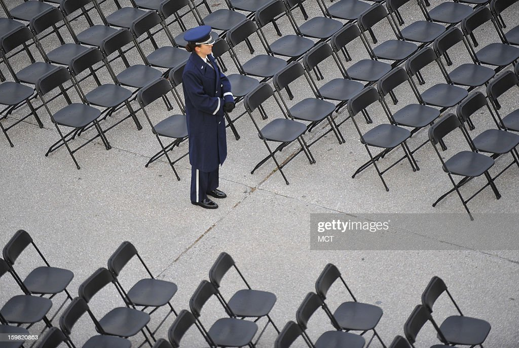A military usher waits to seat guests at the U.S. Capitol, Monday, January 21, 2013, for the second inauguration of President Barack Obama in Washington, D.C.
