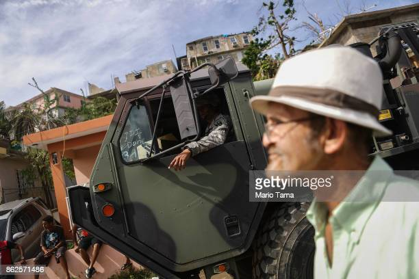 S military vehicle arrives to pass out food and water provided by FEMA to residents in a neighborhood without grid electricity or running water on...
