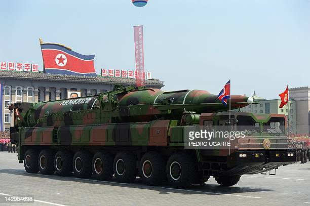 A military vehicle carries what is believed to be a Taepodongclass missile Intermediary Range Ballistic Missile about 20 meters long during a...