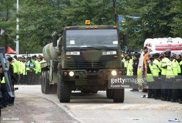 A US military vehicle transports materials for the Terminal High Altitude Area Defense interceptor on Sept 7 in Seongju southeast of Seoul amid...