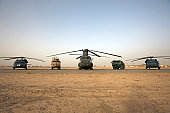 U.S. military vehicles and aircraft lined up on the taxiway at Camp  Speicher, Iraq.
