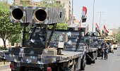 Military vehicles belonging to the Iraqi Defense and Interior Ministry attend a parade prior to Republic Day in Baghdad Iraq on July 12 2016