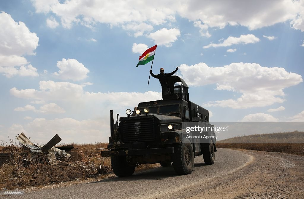 Military vehicles belonging to the Peshmerga forces are seen as they conduct an operation against Daesh terrorists in Nineveh, Iraq on May 30, 2016.