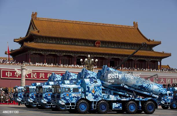 Military vehicles carry DF10 ship launched cruise missiles drive past the Tiananmen Gate during a military parade to mark the 70th anniversary of the...
