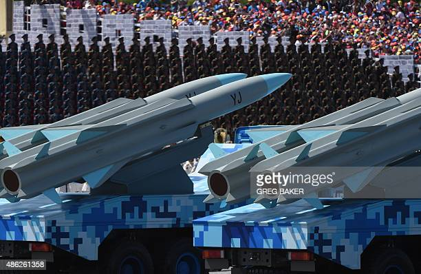 Military vehicles carrying cruise missiles participate in a military parade at Tiananmen Square in Beijing on September 3 to mark the 70th...
