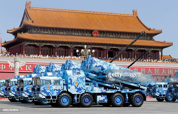 Military vehicles carrying shoretoship missiles drive past the Tiananmen Gate during a military parade to mark the 70th anniversary of the end of...
