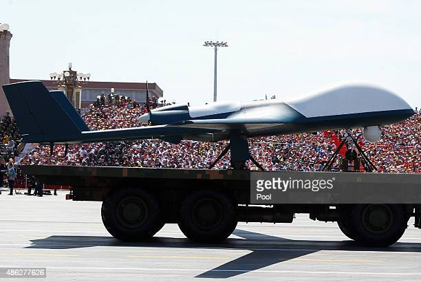 Military vehicles drive past the Tiananmen Gate during a military parade to mark the 70th anniversary of the end of World War Two on September 3 2015...