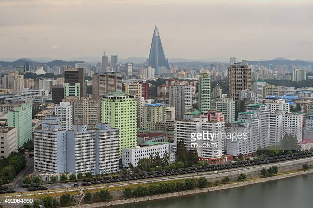 Military vehicles line up on a road in Pyongyang on October 10 2015 North Korea is gearing up for a lavish celebration marking the 70th anniversary...