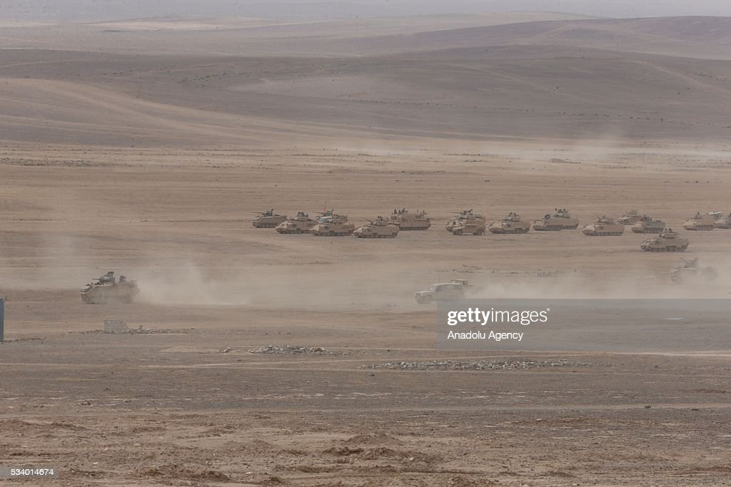 Military vehicles of United States and Jordan move on the Azraq desert as they take part in the joint 'Eager Lion 16' Military Drill in capital Amman, Jordan on May 24, 2016. Village saving operation is carried out with Challanger and Abrams tanks as they use other ammunition during the military drill.