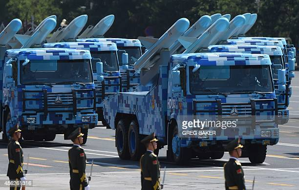 Military vehicles participate in a military parade at Tiananmen Square in Beijing on September 3 to mark the 70th anniversary of victory over Japan...