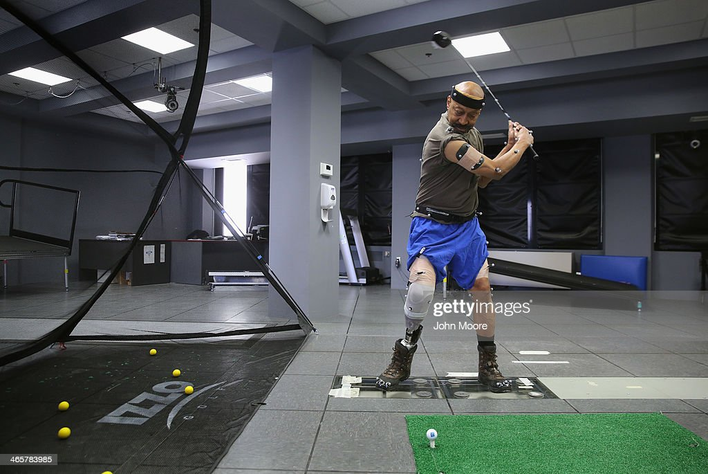U.S. Military veteran and amputee Lloyd Epps swings a driver while at the gait and motion analysis lab at the Veterans Administration (VA), hospital on January 29, 2014 in Manhattan, New York City. Epps, who lost his leg to an infection in 2010, wears a hightech custom prosthetic from the VA which powers his gait forward. At the gait and motion lab patients are fitted with reflectors which are filmed by multiple cameras and analyzed to help them improve mobility after losing limbs.