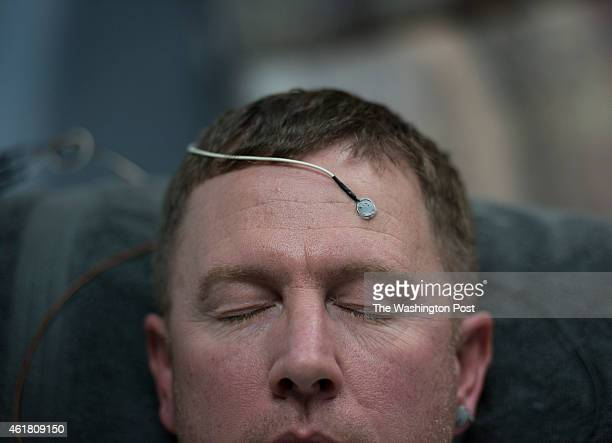 Military veteran Cliff Drake is hooked up to neurofeedback electrodes / sensors at Brainsake a brain wellness and biofeedback center in Bethesda MD...