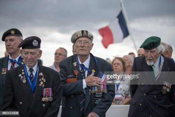 Military veterans and passengers gather for a wreath laying ceremony at sea on board the Brittany cross channel ferry Normandie travelling from...