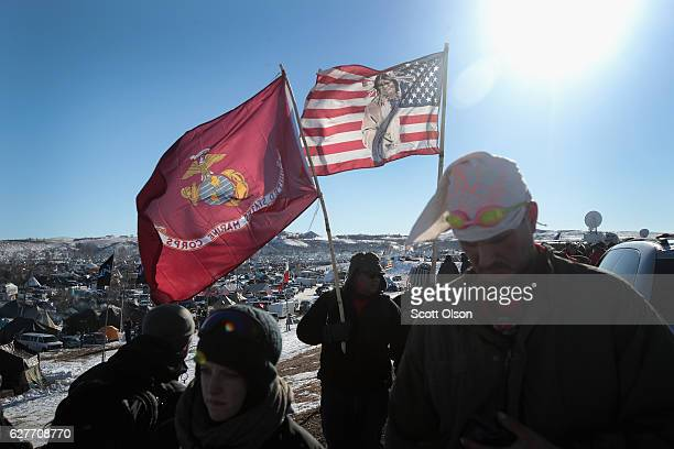 Military veterans arrive to support activists at Oceti Sakowin Camp on the edge of the Standing Rock Sioux Reservation on December 4 2016 outside...