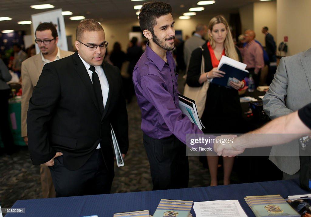 S Military veterans Carlos Villanueva Hector Villanueva and Pamela Springle listen as a recruiter for Internal Revenue Service explains the jobs...