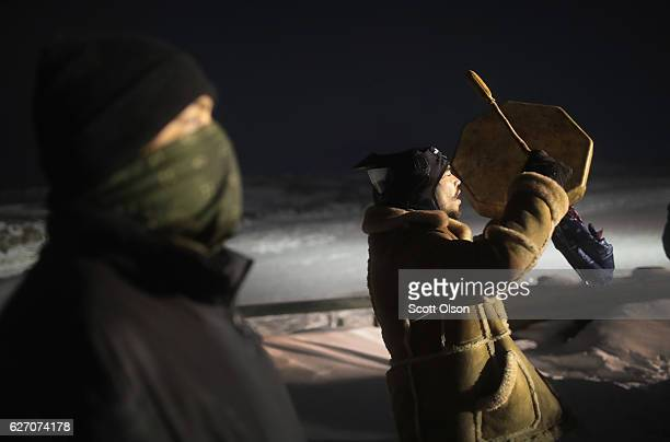 Military veterans confront police guarding a bridge near Oceti Sakowin Camp on the edge of the Standing Rock Sioux Reservation on December 1 2016...