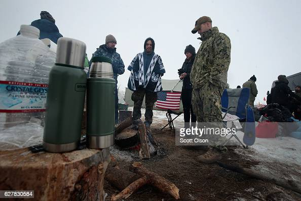Military veterans from Southern California keep warm around their campfire at Oceti Sakowin Camp on the edge of the Standing Rock Sioux Reservation...