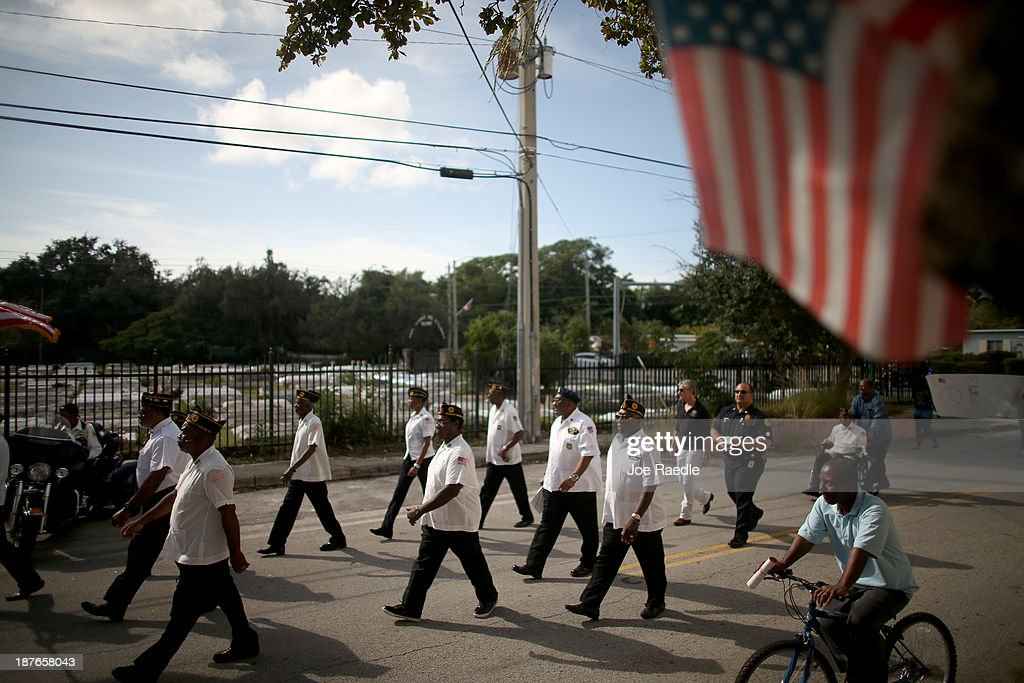 Military veterans march in a Veterans Day ceremony on November 11, 2013 in Coconut Grove, Florida. The ceremony was held by the Coconut Grove American Legion Post #182 in honor of those veterans who have served the United States.