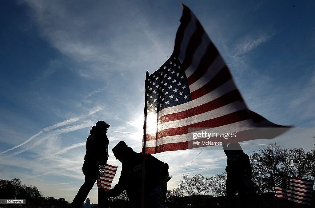 S military veterans set up 1892 American flags on the National Mall March 27 2014 in Washington DC The Iraq and Afghanistan Veterans of America...