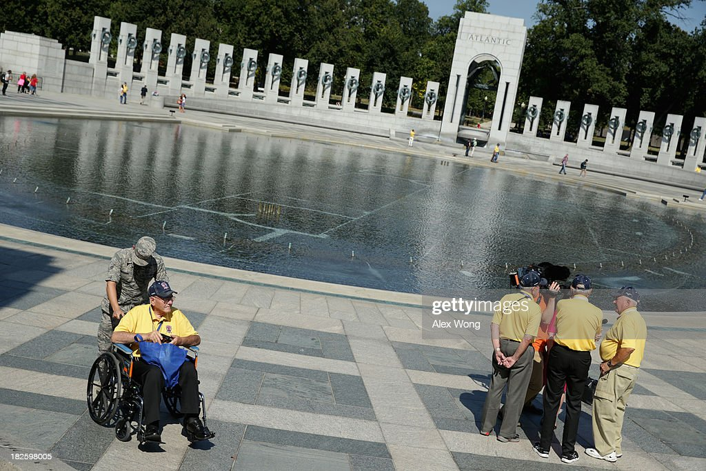 Military veterans visit the World War II Memorial as some of them are interviewed by news media during a government shutdown October 1, 2013 in Washington, DC. The memorial was temporary opened to veteran groups arrived on Honor Flights on a day trip to visit the nation's capital.