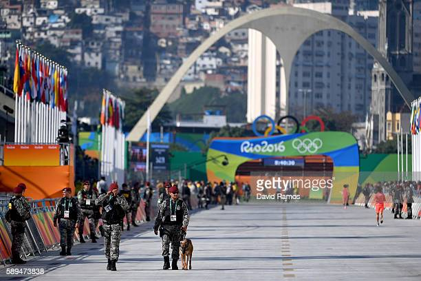 Military walks along the start of the course before the start of the Women's Marathon on Day 9 of the Rio 2016 Olympic Games at the Sambodromo on...