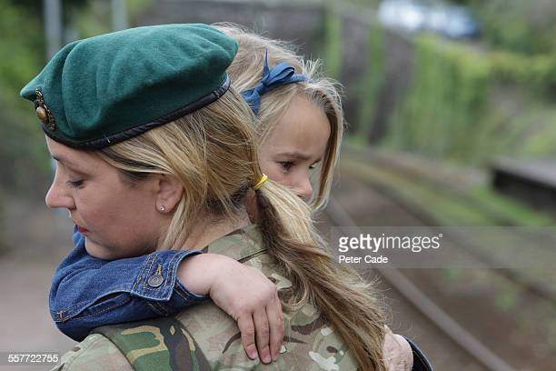 military woman leaving for service ,train station,