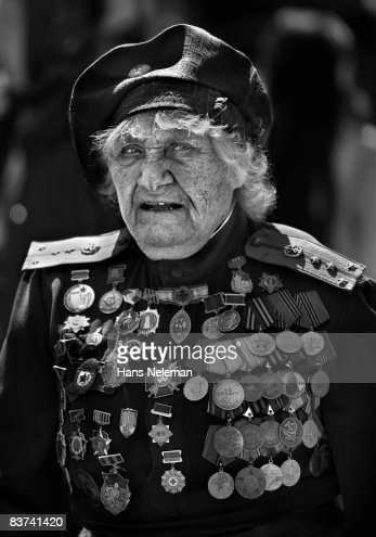 military-woman-wearing-a-lot-of-medals-picture-id83741420