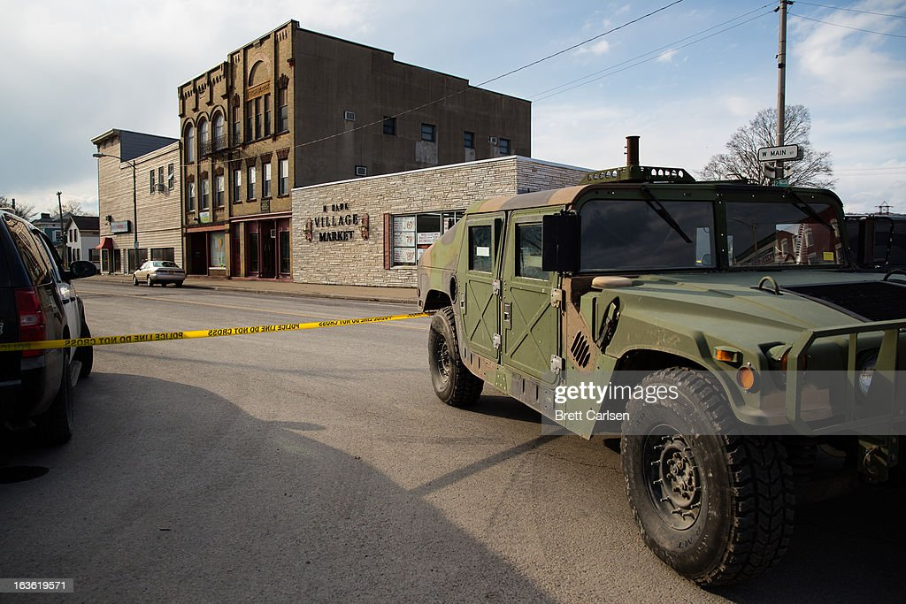 A military-style vehicle sits on West Main Street as part of a road block related to the shooting spree that left four dead and two wounded in the area on March 13, 2013 in Mohawk, New York. Police have identified 64-year-old Kurt Meyers as a possible suspect responsible for a total of four shooting deaths and two injuries across the area earlier in the day.