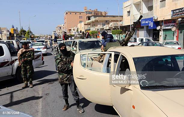 Militia fighters man a checkpoint in the Libyan city of Sabratha on February 27 2016 The city west of the capital had been the scene of fierce...