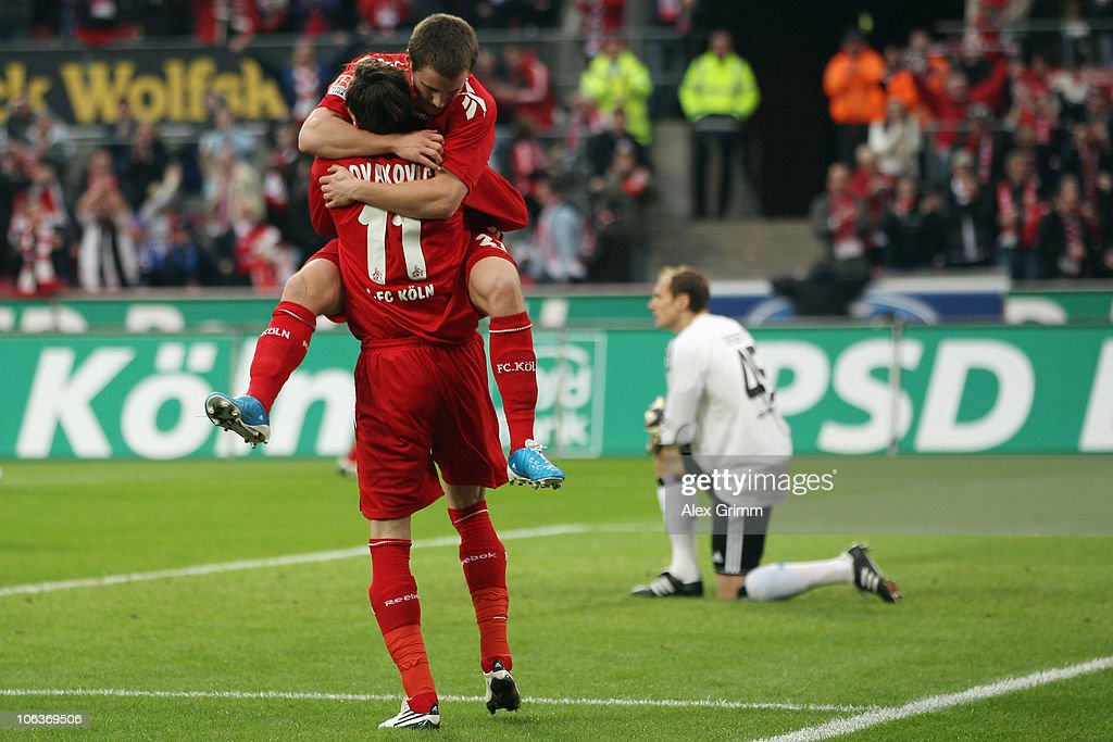 Milivoje Novakovic of Koeln celebrates his team's second goal with team mate Christian Clemens during the Bundesliga match between 1 FC Koeln and Hamburger SV at the RheinEnergieStadion on October 30, 2010 in Cologne, Germany.