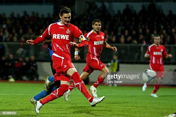 Milivoje Novakovic of Koeln scores the first goal during the DFB Cup round of 16 match between Eintracht Trier and 1 FC Koeln at the Mosel stadium on...