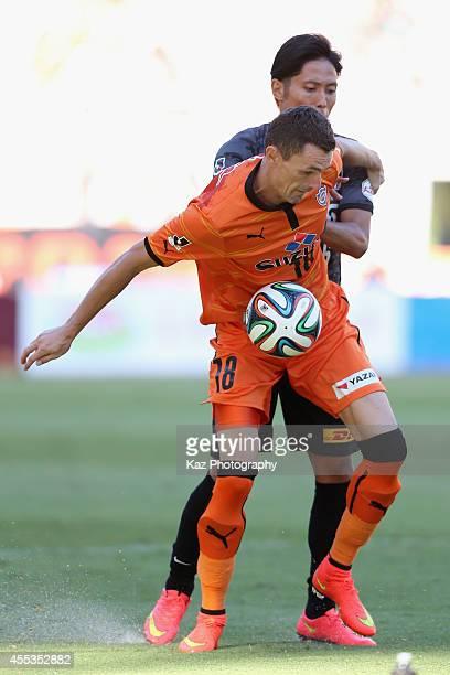 Milivoje Novakovic of Shimizu SPulse and Ryota Moriwaki of Urawa Reds compete for the ball during the JLeague match between Shimizu SPulse and Urawa...