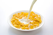Milk Being Poured Onto Cornflakes