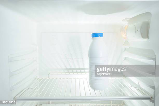 Milk bottle in refrigerator
