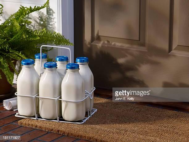 Milk bottles on front porch