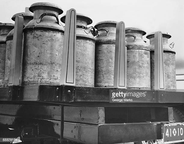 Milk canisters on truck