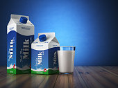 Milk carton packand glass on blue background. 3d illustration