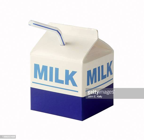 Milk carton with straw on white