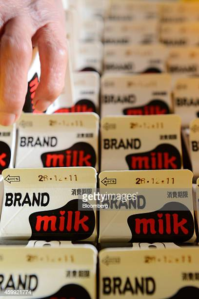 Milk cartons sit packed in a crate at the production facility of a Kawashima Dairy Farm in Chiyoda Gunma Prefecture Japan on Wednesday Dec 3 2014...