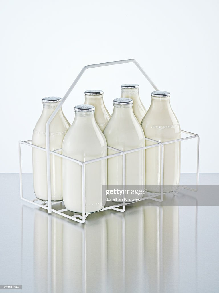 Milk holder with milk bottles : Stock Photo