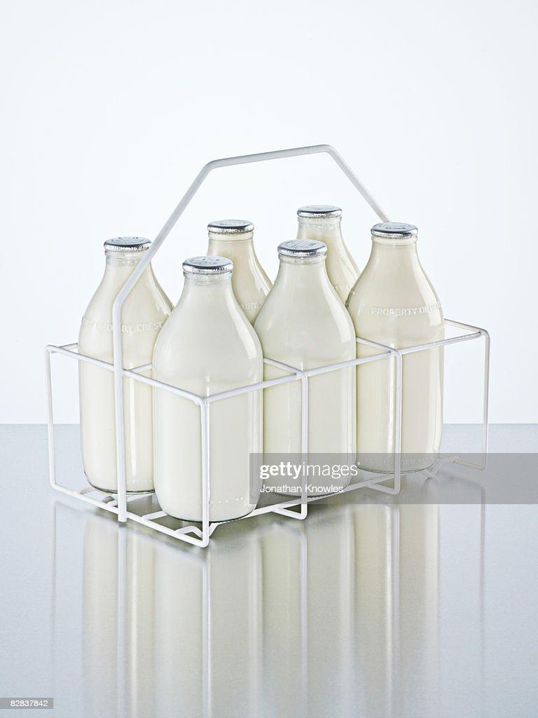 Milk holder with milk bottles